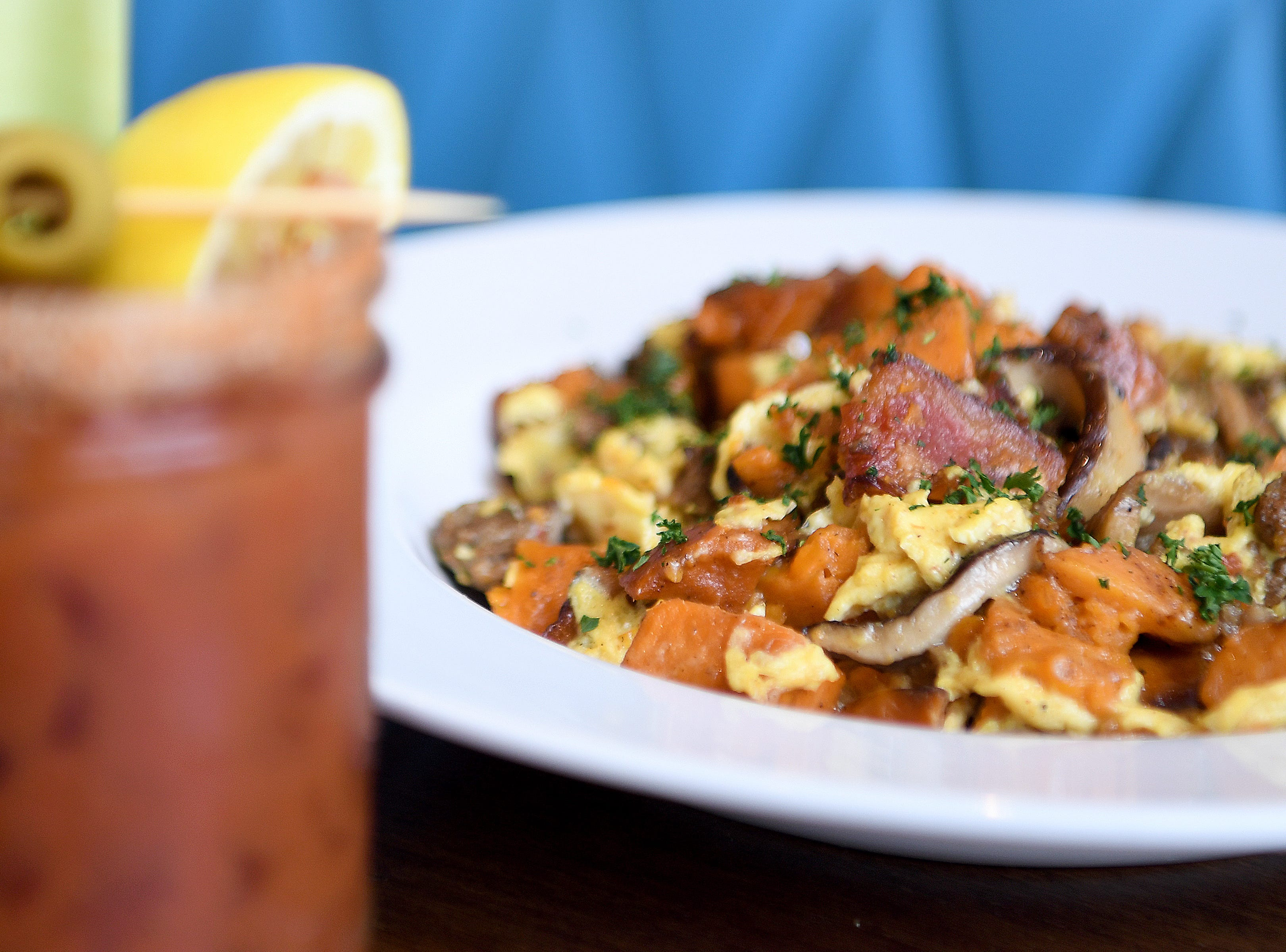The local sausage and sweet potato scramble at Early Girl's West Asheville location is scrambled eggs with local sausage, shiitake mushrooms, sweet potatoes, bacon and green onions.