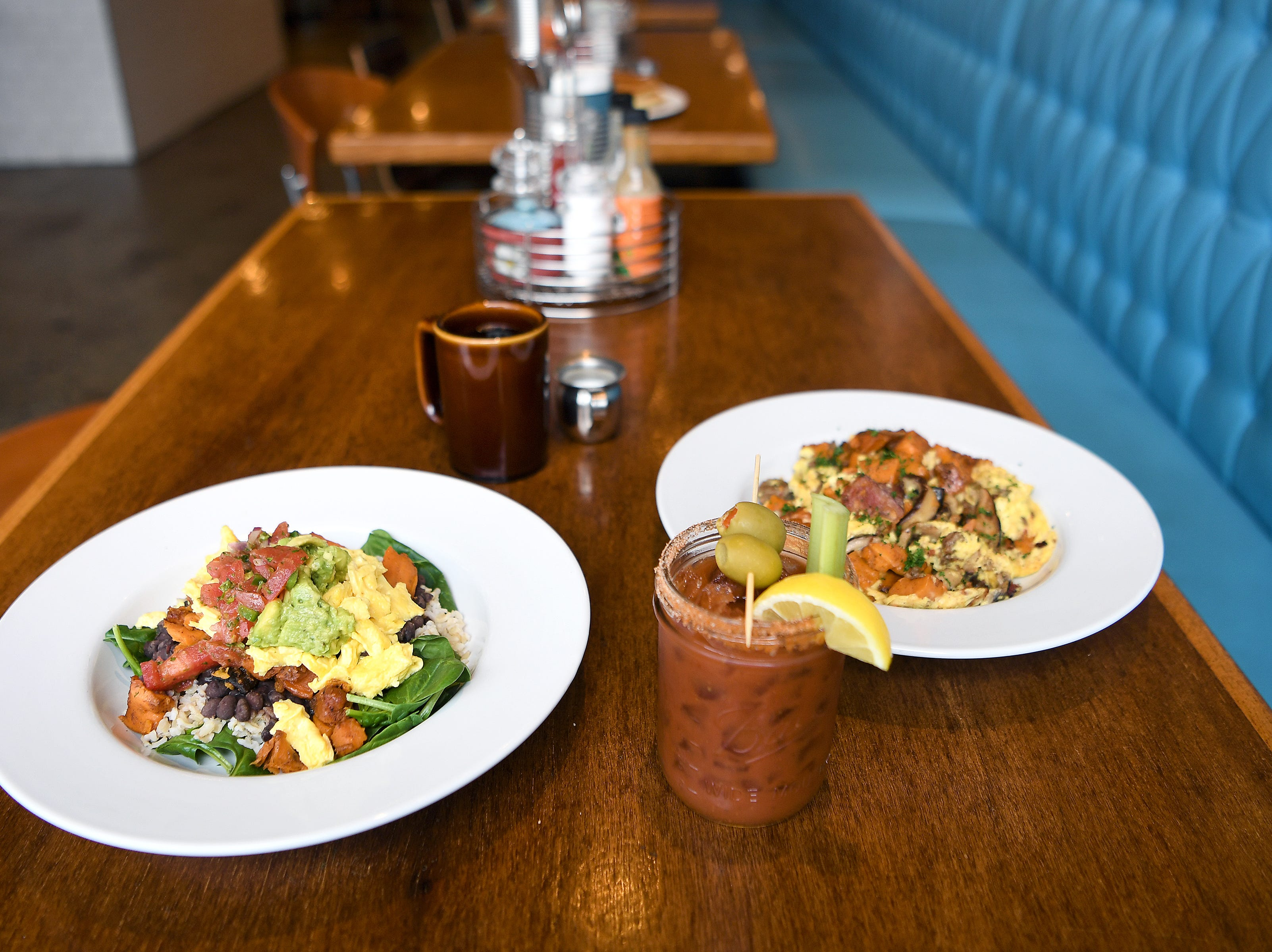 Two breakfast bowls at Early Girl's West Asheville location are the veggie breakfast bowl and the local sausage and sweet potato scramble,