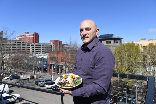 Anthony Cerrato, chef and owner of Strada, holds a Mediterranean Bowl available at his downtown restaurant for lunch. The bowl, which costs $10, is made with farro, feta cheese, olives, tomatoes, cucumbers, red onions, oregano, fresh spinach and dressed.