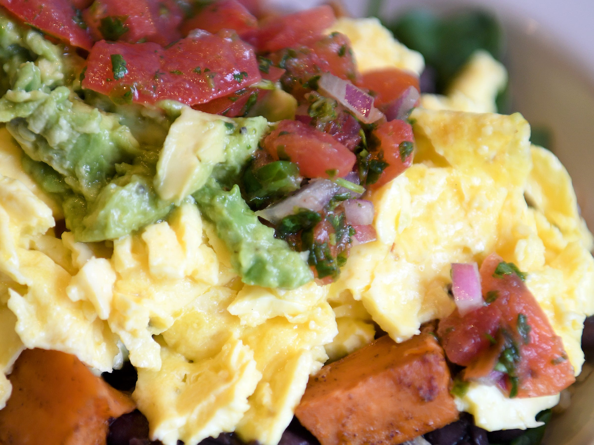 The veggie breakfast bowl at Early Girl's West Asheville location is rice, black beans, sweet potatoes, fresh spinach, aged cheddar cheese and scrambled eggs topped with salsa and avocado relish.
