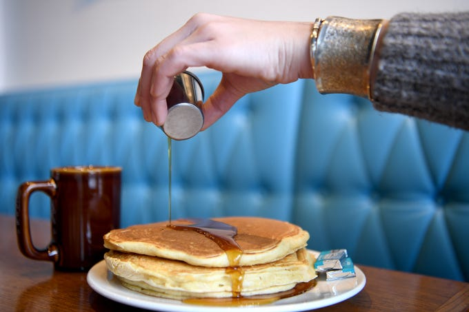 The multigrain pancakes at Early Girl's West Asheville location are served with Vermont organic maple syrup.