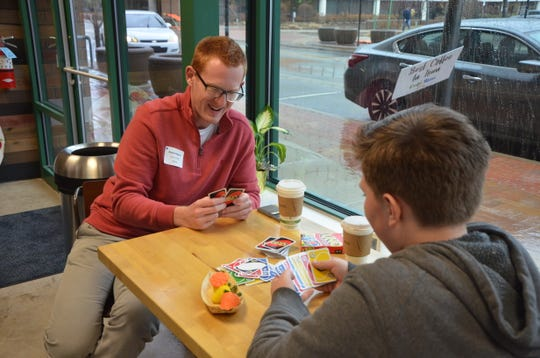 Playing Uno at Cafe Rica is one of the activities Adam Kingston (left) and Jonathon Michaud enjoy doing during their time together as part of the Big Brothers Big Sisters Bigs in Business program.