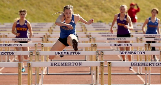 Bremerton's Lauryn Chandler (second from left)  will be one of the featured athletes expected to compete at the Lil' Norway Invitational track and field meet at North Kitsap High School on April 13. Chandler won two state titles with the Knights last spring.
