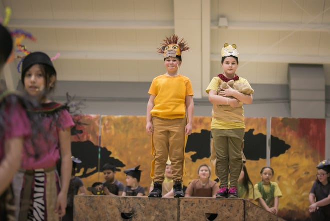 "Justin Soriano, left,  as Mufasa and Kaydence Ockerman, as Sarabi, welcome baby Simba in View Ridge Elementary Arts Academy's production of ""The Lion King KIDS"" in a dress rehearsal earlier this month at the East Bremerton Community Gym. The school was selected to take part in the Disney Musicals in Schools program for the 2018-19 school year."