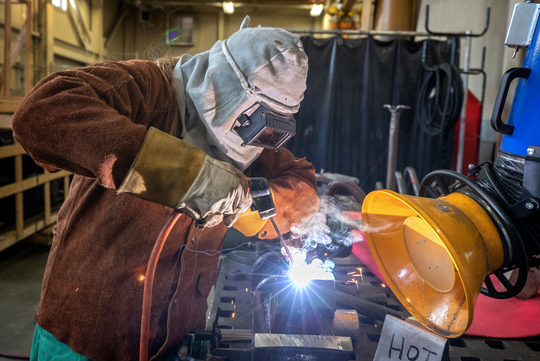 Katherine LaPierre of Belfair works on a shielded metal arc welding project March 14 at Puget Sound Naval Shipyard and Intermediate Maintenance Facility.