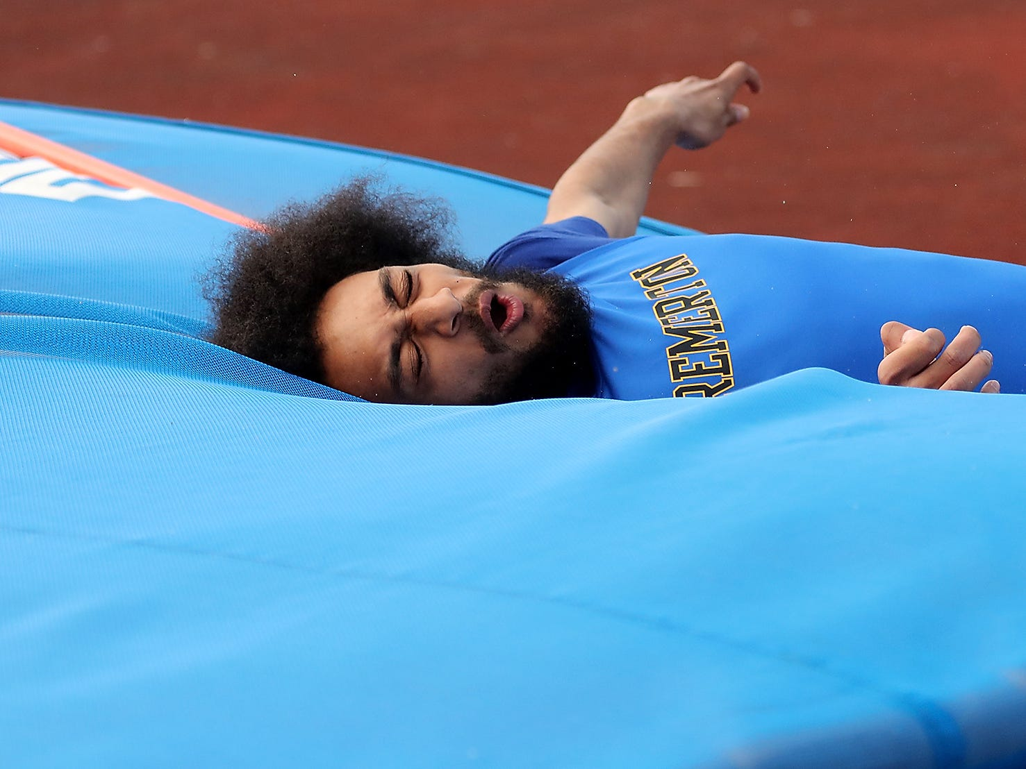 Bremeton's A'ziah Hassan hits the mat and reacts to a failed high jump on Thursday, March 21, 2019.