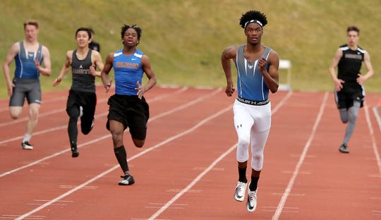 Olympic's Adam Johnson leads the way in the 200-meter dash during a meet at Bremerton High School on Thursday, March 21, 2019.
