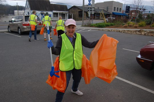 Black Mountain Beautification Committee member Tracy Munn participates in a litter sweep last fall.