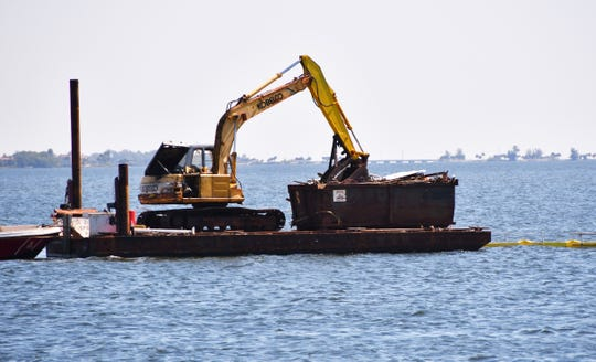 The remains of a derelict boat removed from the Indian River just south of the Eau Gallie Causeway on Friday.