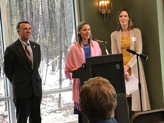 Amy Cooper addresses the audience at the ribbon cutting for Green Mountain Surgery Center, flanked by Gov. Phil Scott and Dr. Susan MacLennan