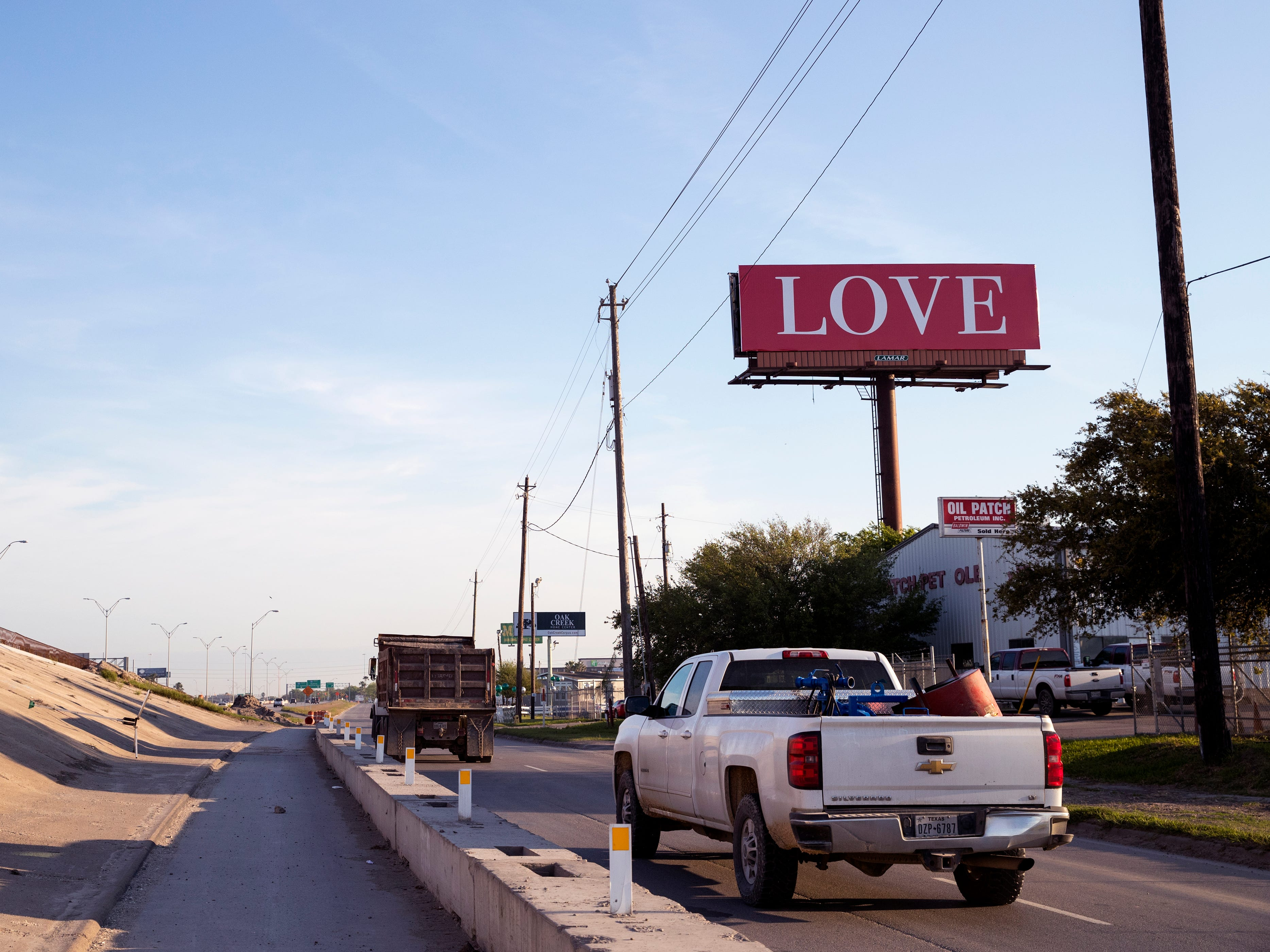 "A red billboard with the word ""LOVE"" on it can be seen along State Highway 358 near Agnes Street as a part of the international ""Love on Every Billboard"" movement. Jamie Rae Hellen, a travel nurse in Corpus Christi, raised funds with her friends to bring a ""LOVE"" billboard to the city."