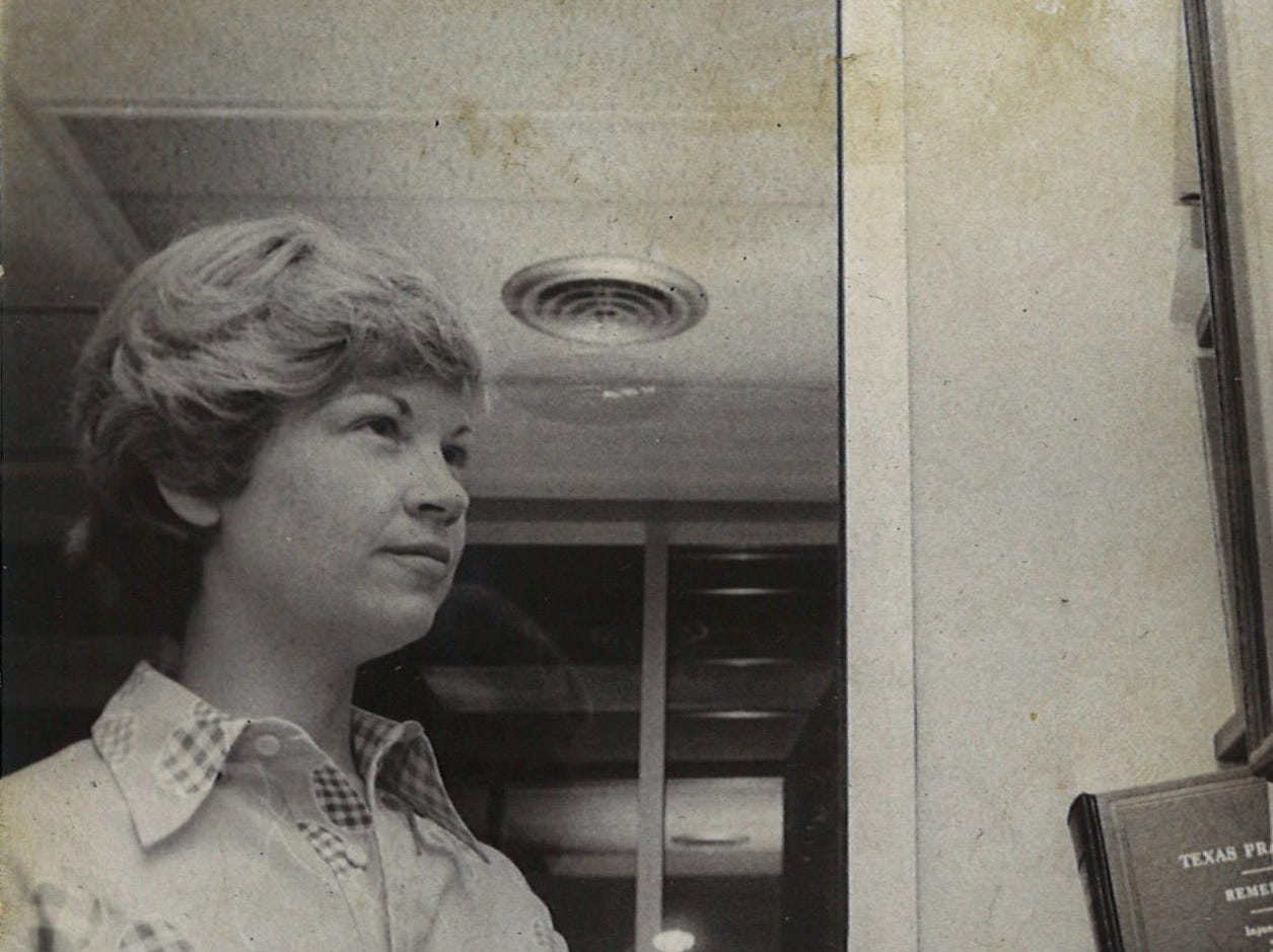 Rene Haas moves books into her new law office in 1975. She passed the bar exam in 1974 and was one of the few female attorneys in Corpus Christi.