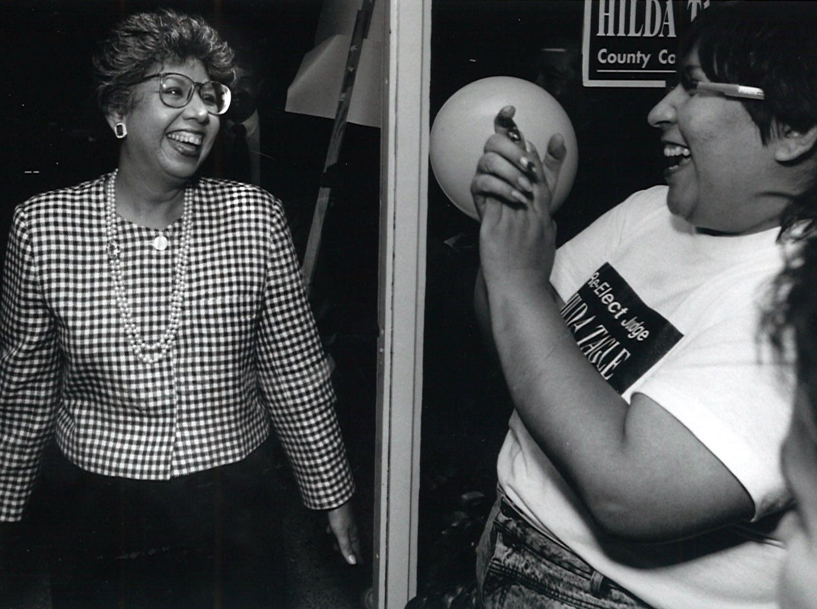 Judge Hilda Tagle (left) arrives at her campaign headquarters on election night, March 13, 1990 as her court reporter Sonia Trevino (right) cheers. Tagle was reelected to the Court-at-Law No. 3 bench.
