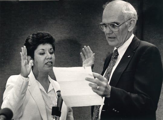 Hilda Tagle is sworn in as the judge of County Court-at-Law No. 3 on July 8, 1986. Nueces County Judge Robert Barnes administered the oath of office.
