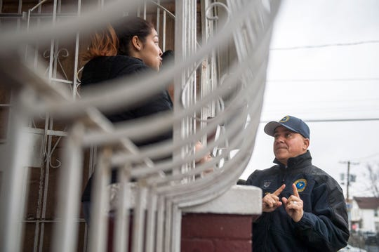 Mayor Frank Moran, right, speaks with resident Frances Gutierrez Friday, March 22, 2019 in East Camden, N.J.