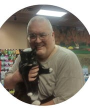 King Kong Bundy holds his cat Gio when he adopted him from Purrfect Angels Cat Rescue in Washington Township.