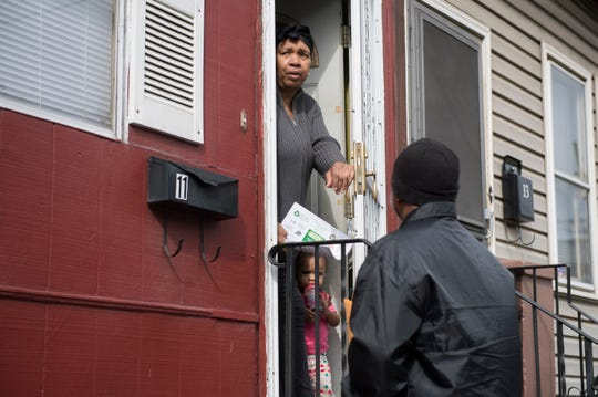 Assistant Chief Housing Inspector Simba El, right, checks on resident Debbie Baker in East Camden Friday, March 22, 2019.