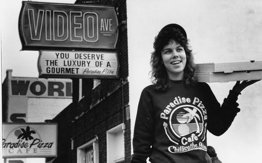 One of the delivery people at Paradise Pizza Cafe poses outside the store in this 1990 file photo.