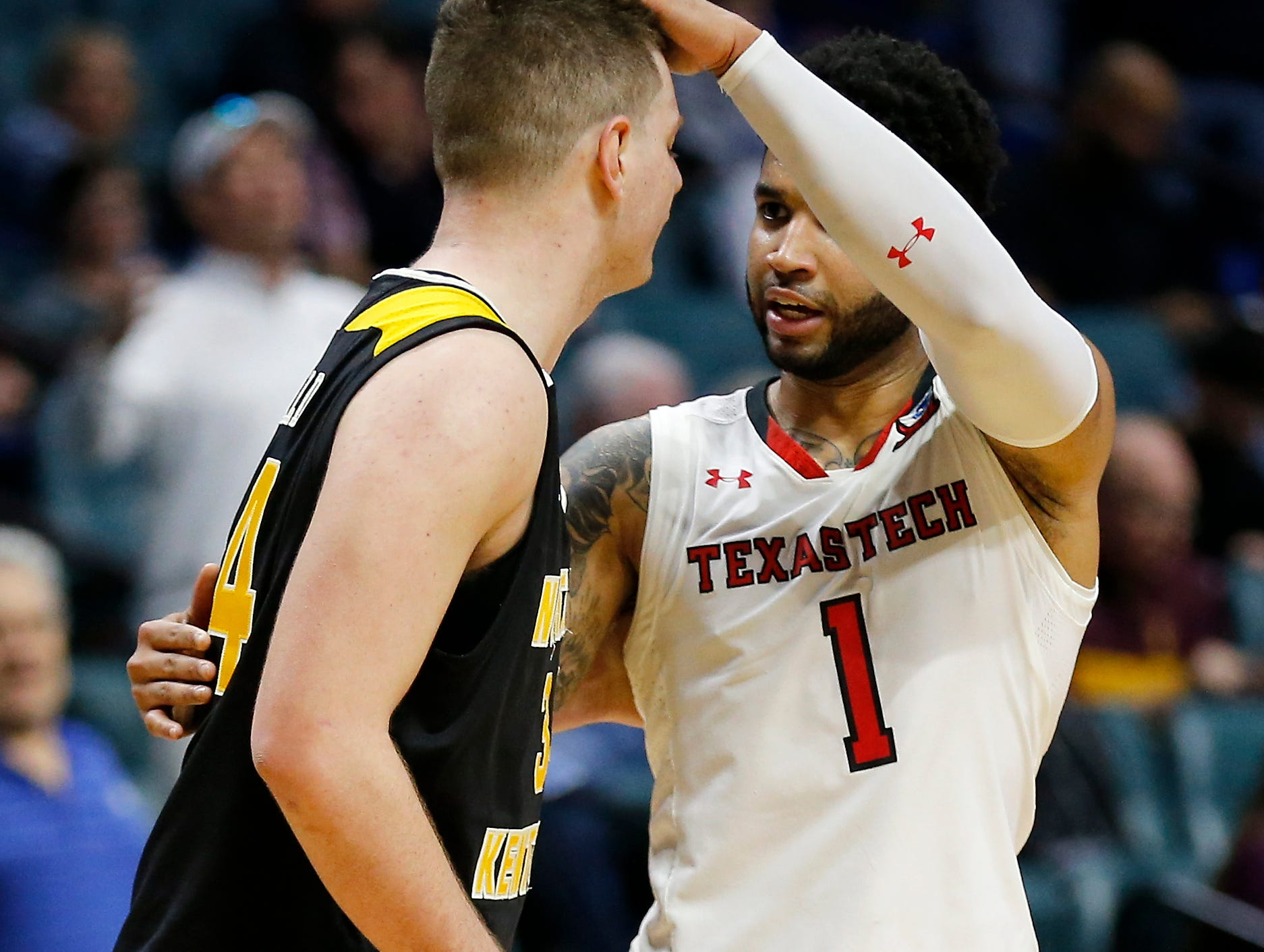 Texas Tech Red Raiders guard Brandone Francis (1) encourages Northern Kentucky Norse forward Drew McDonald (34) at the end of the second half of the NCAA Tournament First Round game between the 14-seeded Northern Kentucky Norse and the 3-seeded Texas Tech Red Raiders the BOK Center in downtown Tulsa on Friday, March 22, 2019. NKU was knocked from the tournament with a 72-57 loss to the Red Raiders.