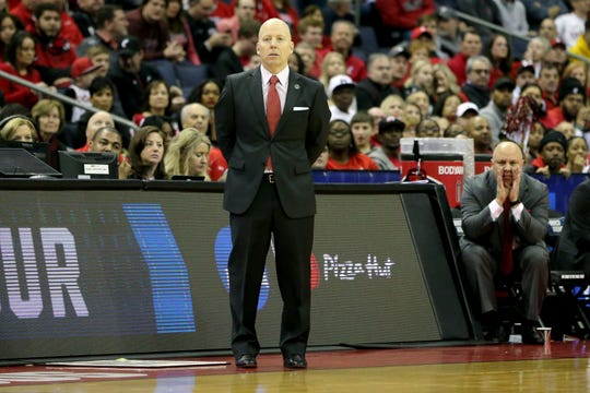 Head coach Mick Cronin observes the team in the first half.
