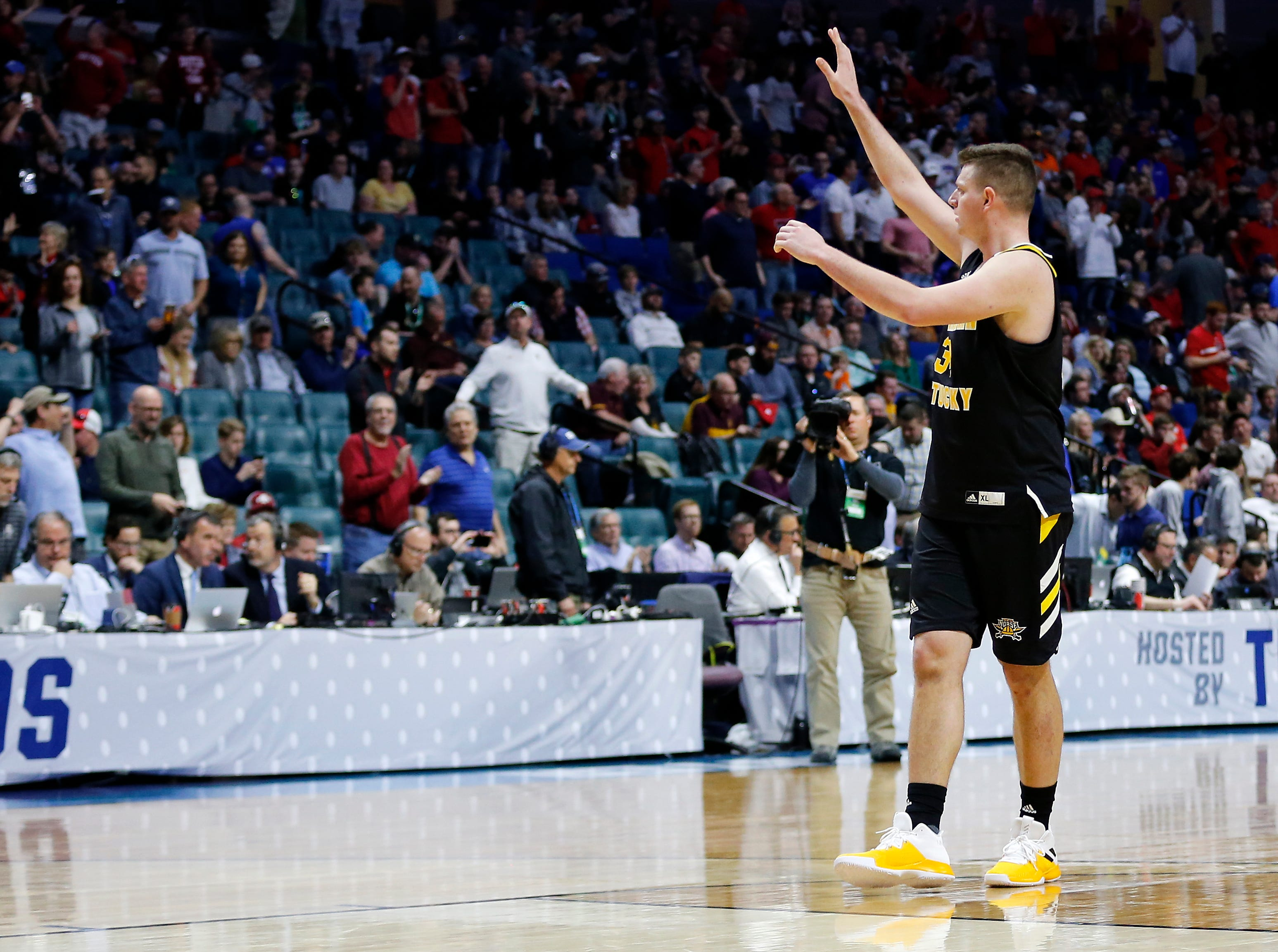 Northern Kentucky Norse forward Drew McDonald (34) waves and thanks the NKU fan section in the second half of the NCAA Tournament First Round game between the 14-seeded Northern Kentucky Norse and the 3-seeded Texas Tech Red Raiders the BOK Center in downtown Tulsa on Friday, March 22, 2019. NKU was knocked from the tournament with a 72-57 loss to the Red Raiders.