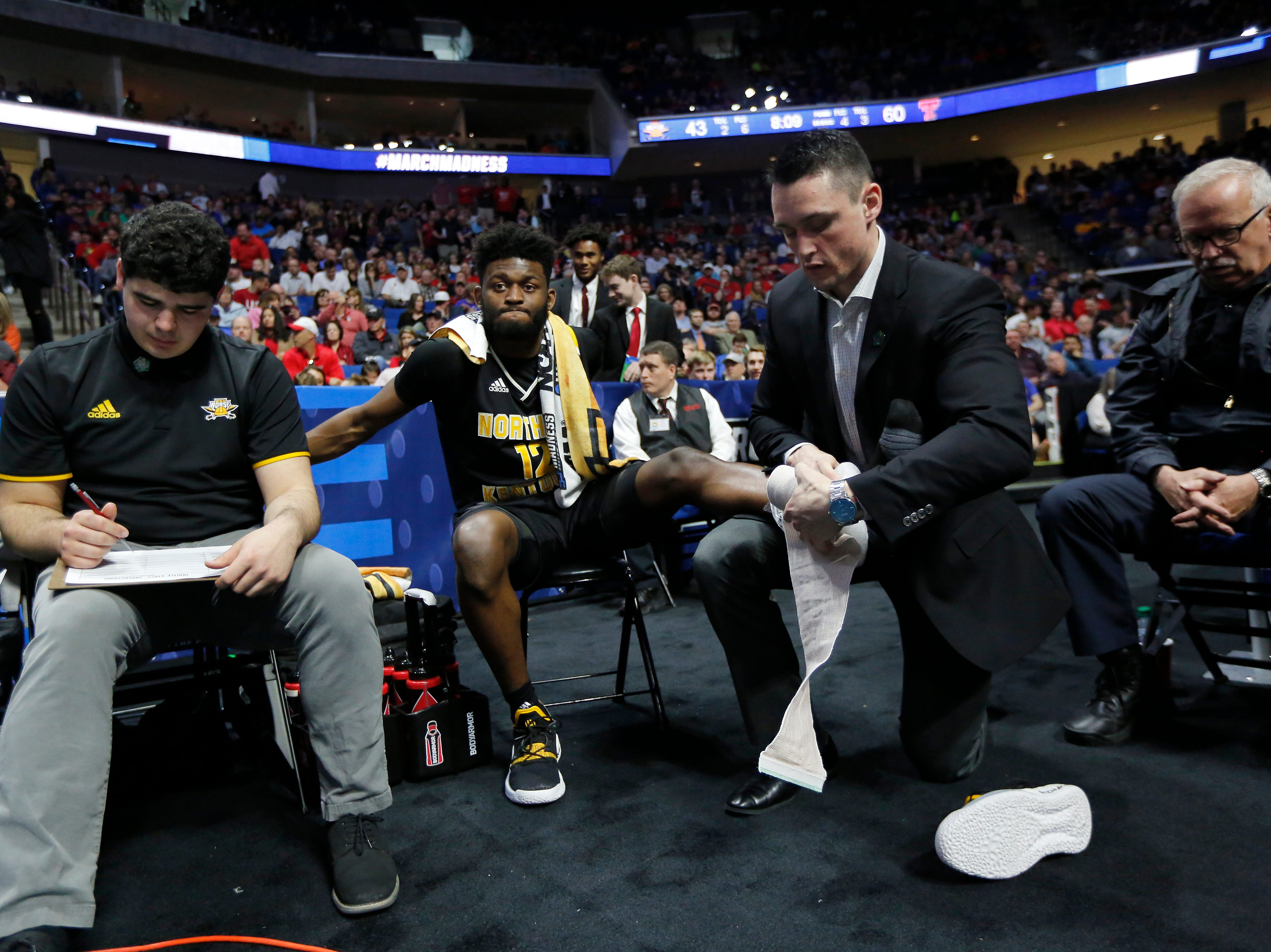 Northern Kentucky Norse guard Trevon Faulkner (12) has his ankle wrapped in ice in the second half of the NCAA Tournament First Round game between the 14-seeded Northern Kentucky Norse and the 3-seeded Texas Tech Red Raiders the BOK Center in downtown Tulsa on Friday, March 22, 2019. NKU was knocked from the tournament with a 72-57 loss to the Red Raiders.