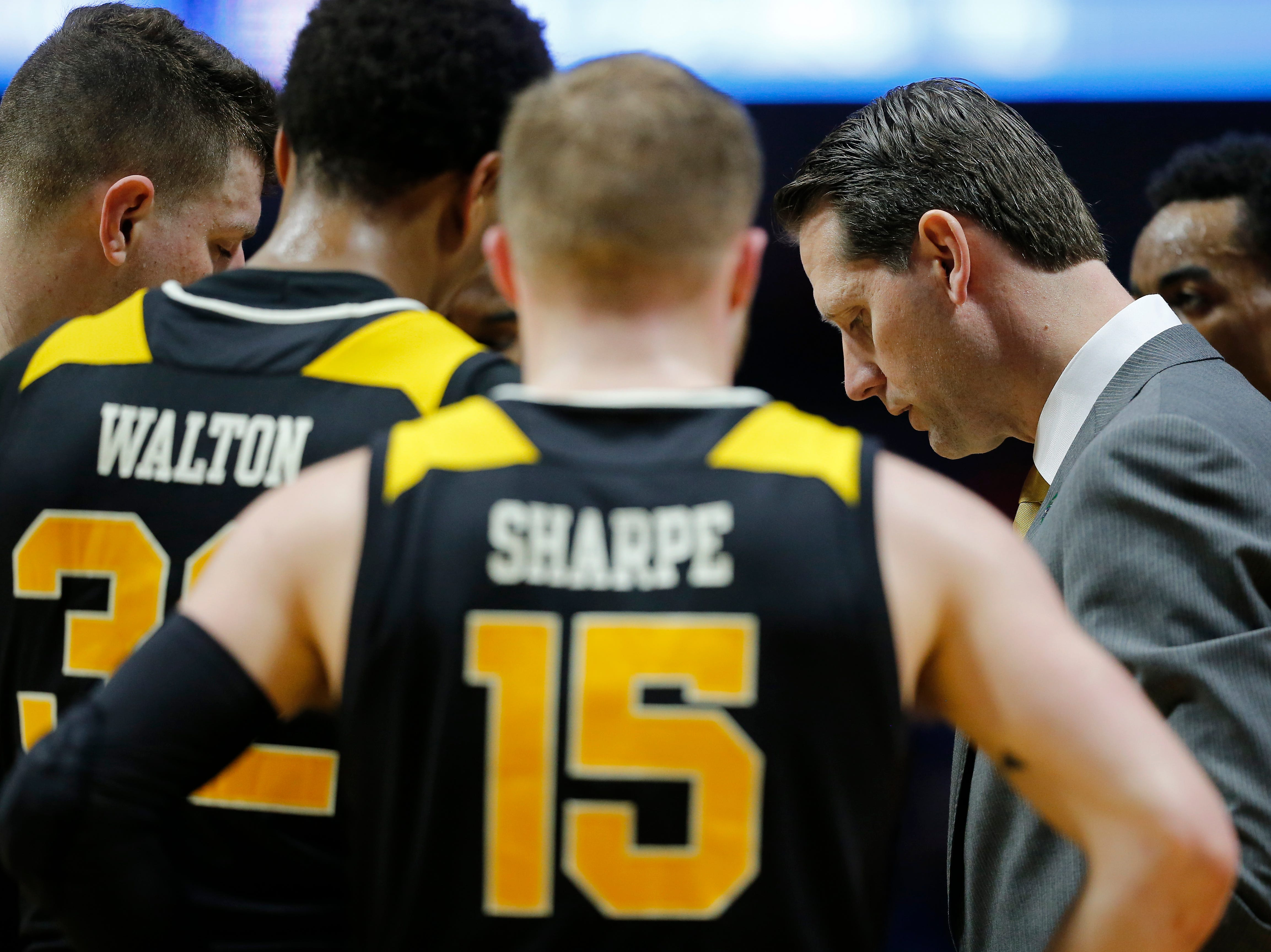 Northern Kentucky Norse head coach John Brannen huddles with his team in the second half of the NCAA Tournament First Round game between the 14-seeded Northern Kentucky Norse and the 3-seeded Texas Tech Red Raiders the BOK Center in downtown Tulsa on Friday, March 22, 2019. NKU was knocked from the tournament with a 72-57 loss to the Red Raiders.