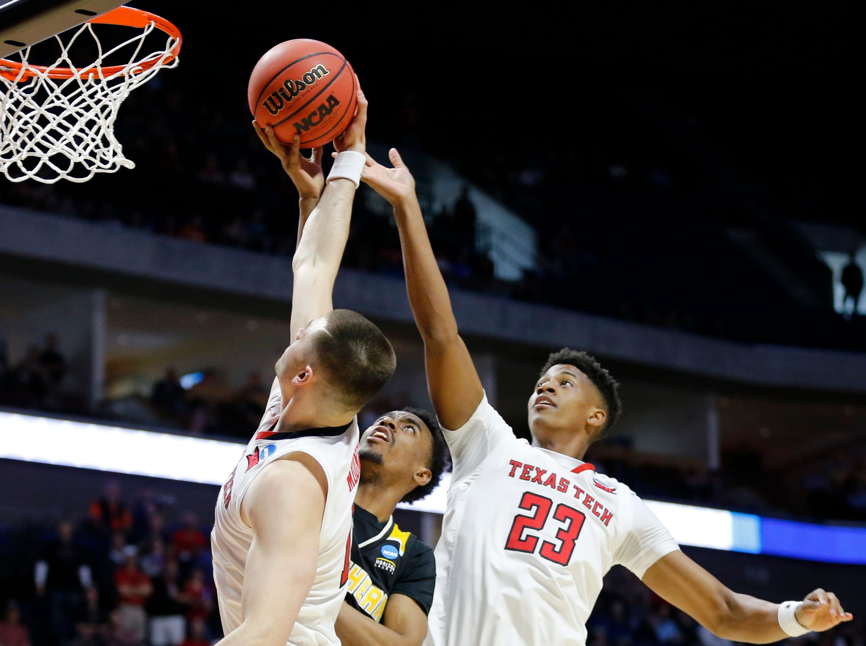 Northern Kentucky Norse guard Jalen Tate (11) goes up for a rebound in the first half of the NCAA Tournament First Round game between the 14-seeded Northern Kentucky Norse and the 3-seeded Texas Tech Red Raiders the BOK Center in downtown Tulsa on Friday, March 22, 2019. Texas Tech led 30-26 at halftime.