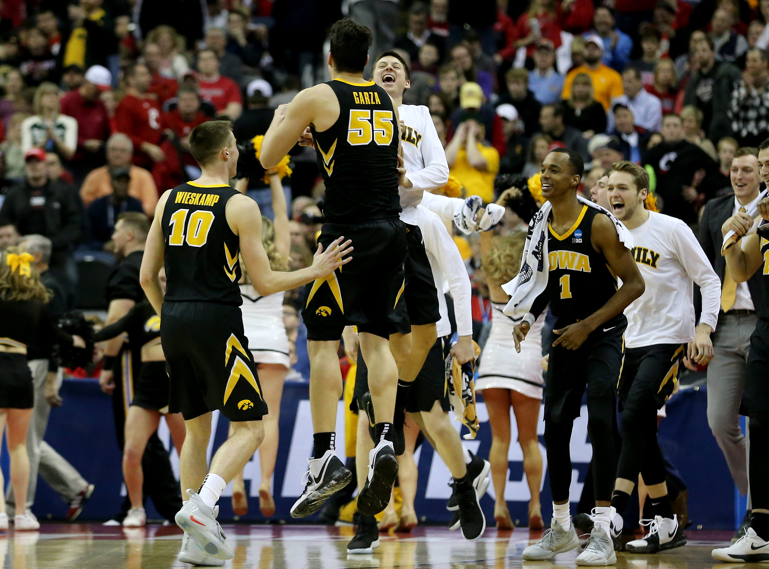 Iowa Hawkeyes forward Luka Garza (55) celebrates the win of the NCAA Tournament Round of 64 game, Friday, March 22, 2019, at Nationwide Arena in Columbus, Ohio. Cincinnati Bearcats lost to the Iowa Hawkeyes 79-72.