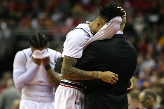 Cincinnati Bearcats senior guard Cane Broome (15) is embraced by Cincinnati Bearcats head coach Mick Cronin in the final moments of the second half of the NCAA Tournament Round of 64 game, Friday, March 22, 2019, at Nationwide Arena in Columbus, Ohio. Cincinnati Bearcats lost to the Iowa Hawkeyes 79-72.