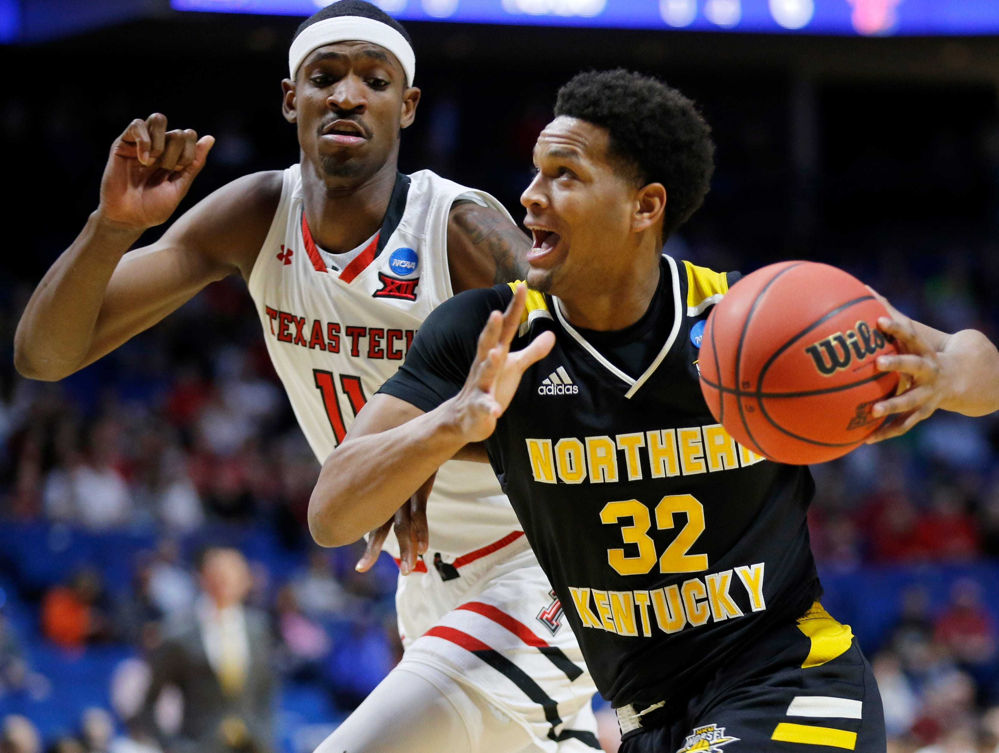 Northern Kentucky Norse forward Dantez Walton (32) drives against Texas Tech Red Raiders forward Tariq Owens (11) in the first half of the NCAA Tournament First Round game between the 14-seeded Northern Kentucky Norse and the 3-seeded Texas Tech Red Raiders the BOK Center in downtown Tulsa on Friday, March 22, 2019. Texas Tech led 30-26 at halftime.