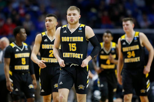 Northern Kentucky Norse guard Tyler Sharpe (15) leads his team back to the floor after a timeout in the first half of the NCAA Tournament First Round game between the 14-seeded Northern Kentucky Norse and the 3-seeded Texas Tech Red Raiders the BOK Center in downtown Tulsa on Friday, March 22, 2019. Texas Tech led 30-26 at halftime.