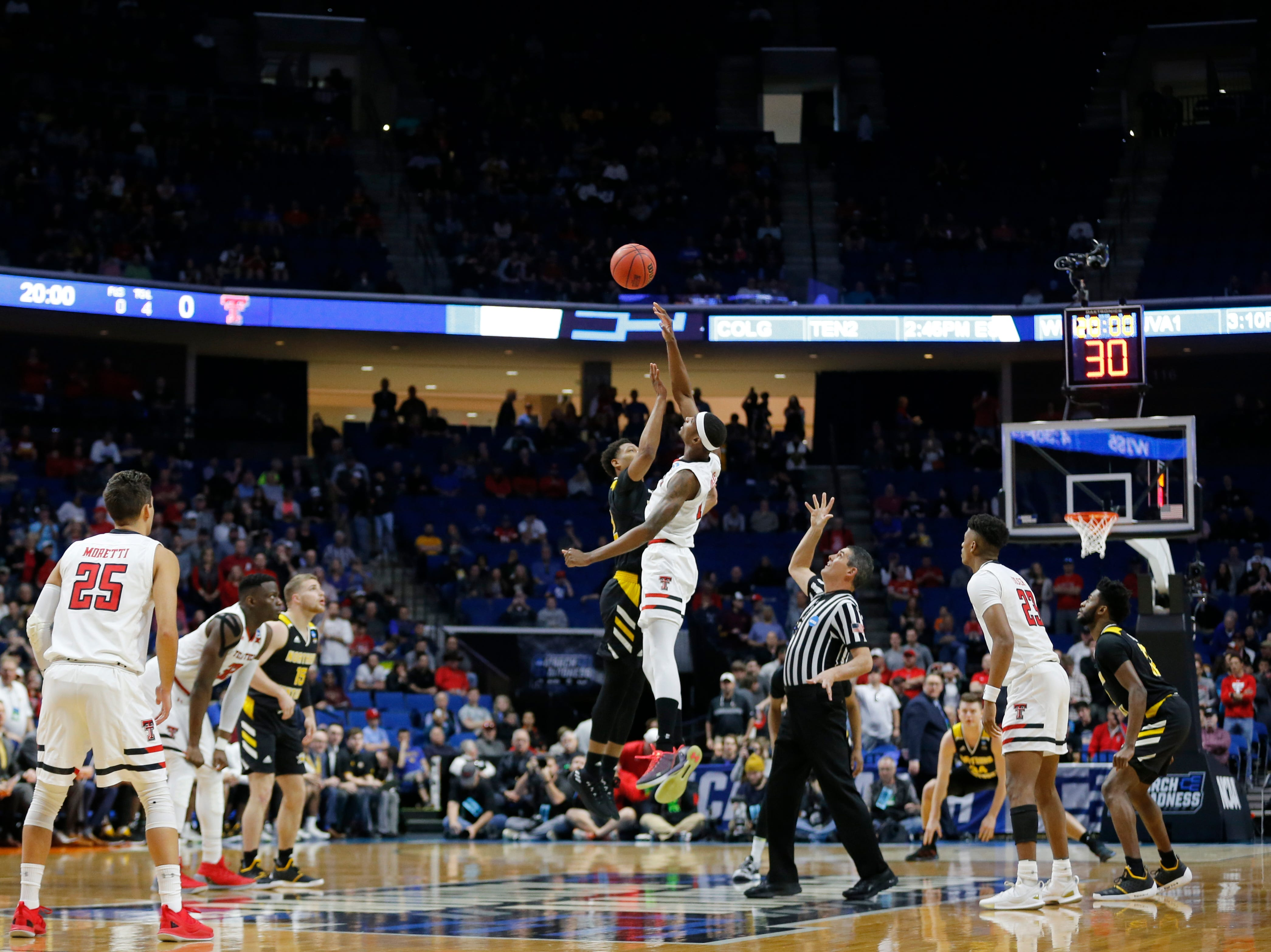 The opening tipoff in the first half of the NCAA Tournament First Round game between the 14-seeded Northern Kentucky Norse and the 3-seeded Texas Tech Red Raiders the BOK Center in downtown Tulsa on Friday, March 22, 2019. Texas Tech led 30-26 at halftime.