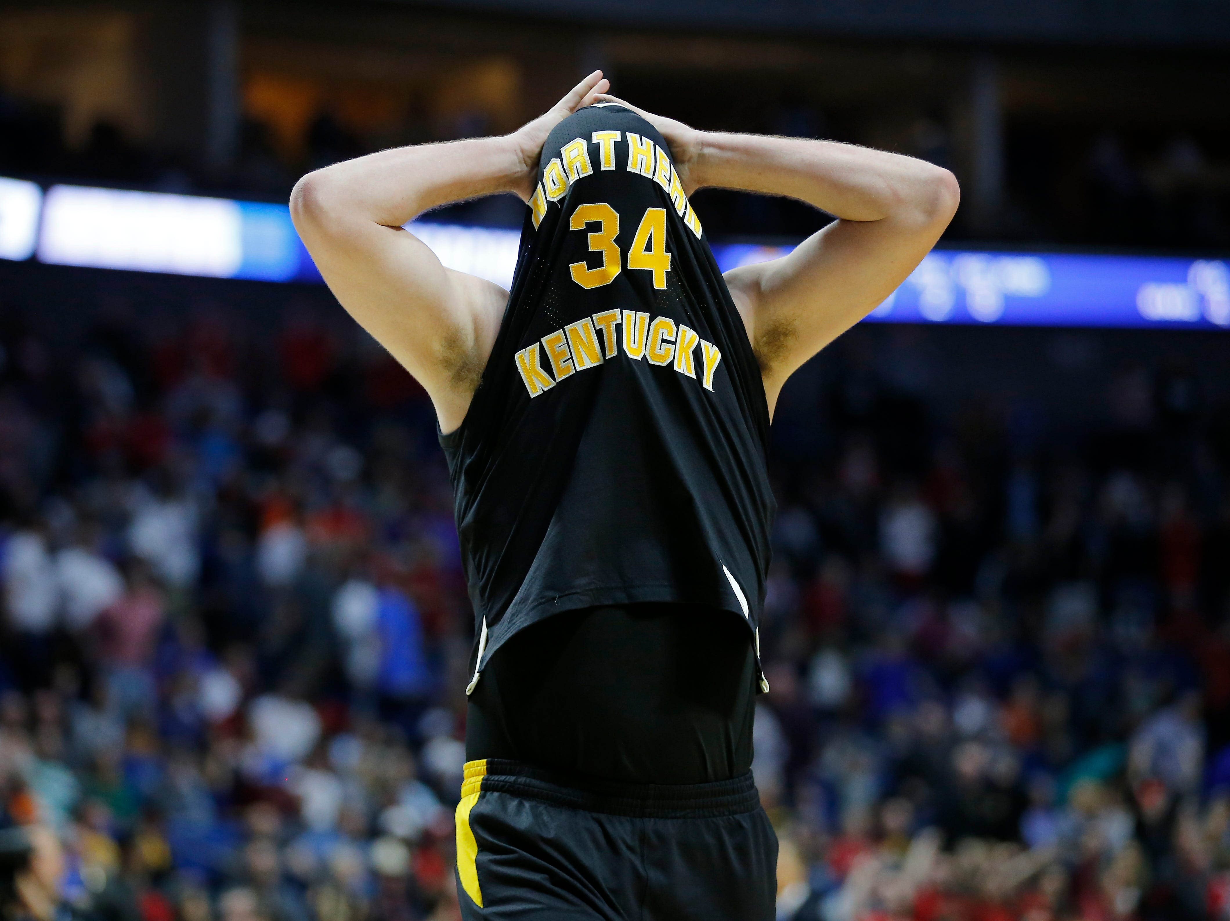Northern Kentucky Norse forward Drew McDonald (34) untucks his shirt and heads for the locker room after the second half of the NCAA Tournament First Round game between the 14-seeded Northern Kentucky Norse and the 3-seeded Texas Tech Red Raiders the BOK Center in downtown Tulsa on Friday, March 22, 2019. NKU was knocked from the tournament with a 72-57 loss to the Red Raiders.