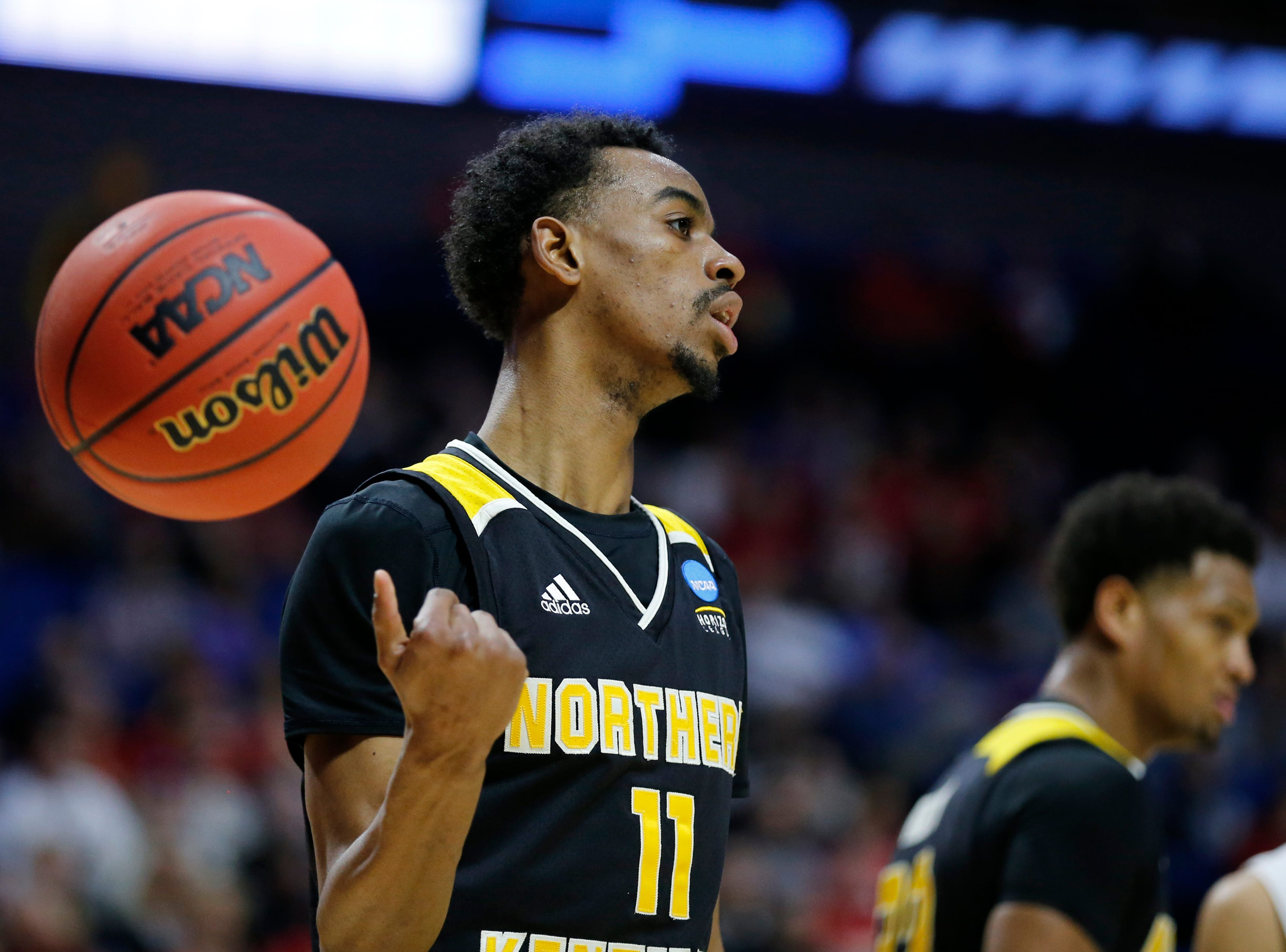 Northern Kentucky Norse guard Jalen Tate (11) tosses the ball away as the clock stops in the first half of the NCAA Tournament First Round game between the 14-seeded Northern Kentucky Norse and the 3-seeded Texas Tech Red Raiders the BOK Center in downtown Tulsa on Friday, March 22, 2019. Texas Tech led 30-26 at halftime.