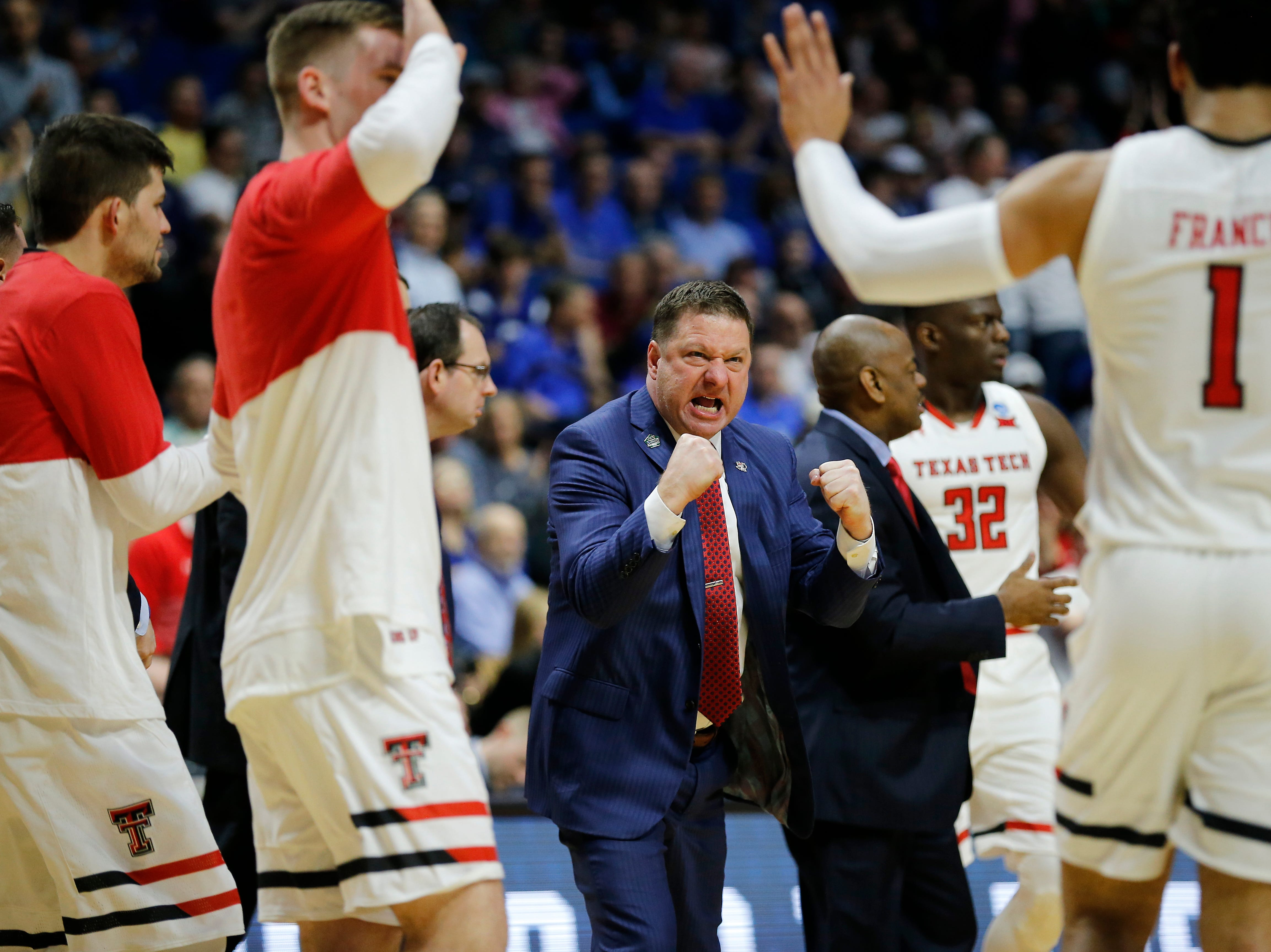 Texas Tech Red Raiders head coach Chris Beard cheers as his team extends a lead in the second half of the NCAA Tournament First Round game between the 14-seeded Northern Kentucky Norse and the 3-seeded Texas Tech Red Raiders the BOK Center in downtown Tulsa on Friday, March 22, 2019. NKU was knocked from the tournament with a 72-57 loss to the Red Raiders.