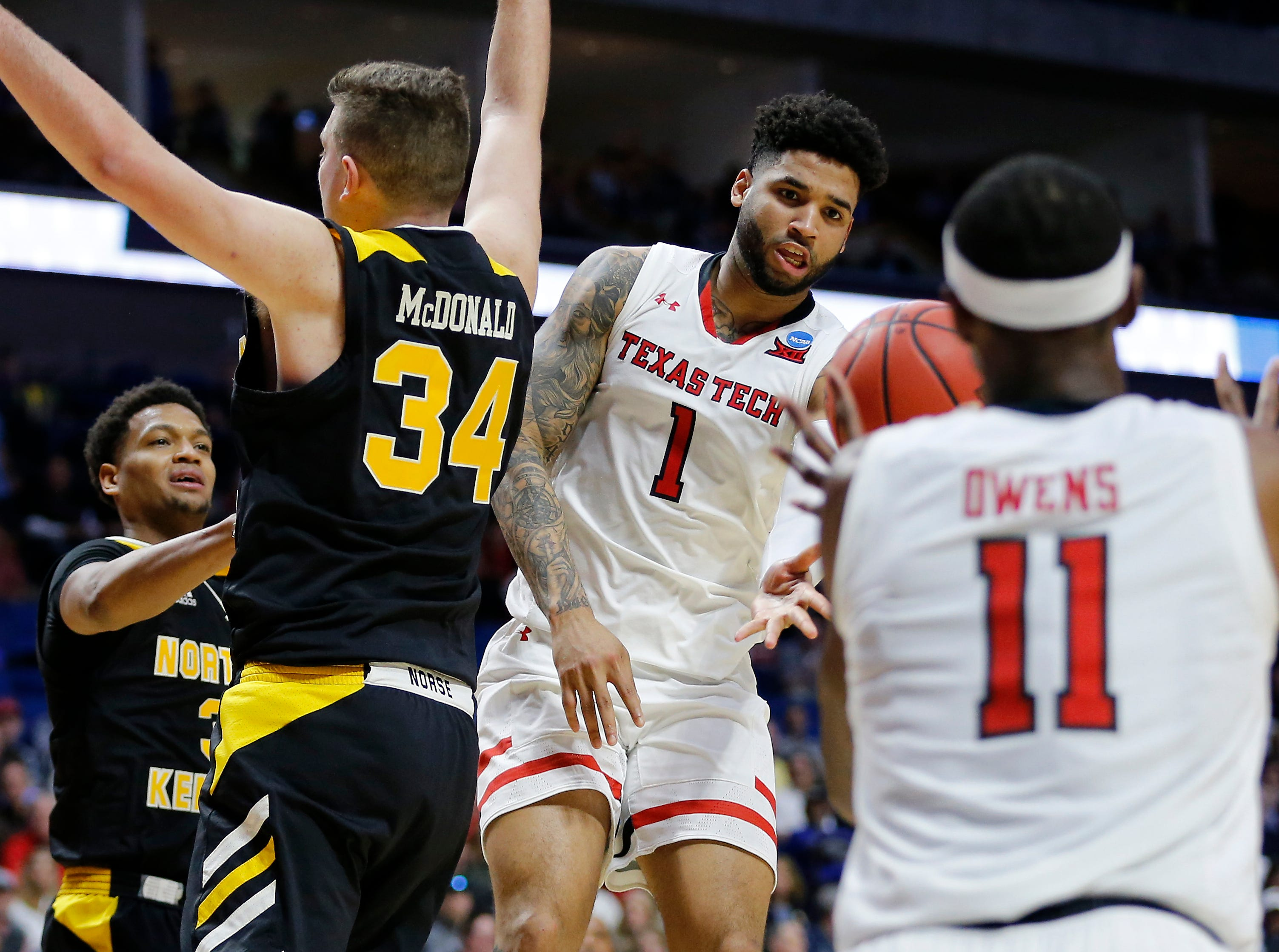 Texas Tech Red Raiders guard Brandone Francis (1) passes out to forward Tariq Owens (11) under the basket in the second half of the NCAA Tournament First Round game between the 14-seeded Northern Kentucky Norse and the 3-seeded Texas Tech Red Raiders the BOK Center in downtown Tulsa on Friday, March 22, 2019. NKU was knocked from the tournament with a 72-57 loss to the Red Raiders.