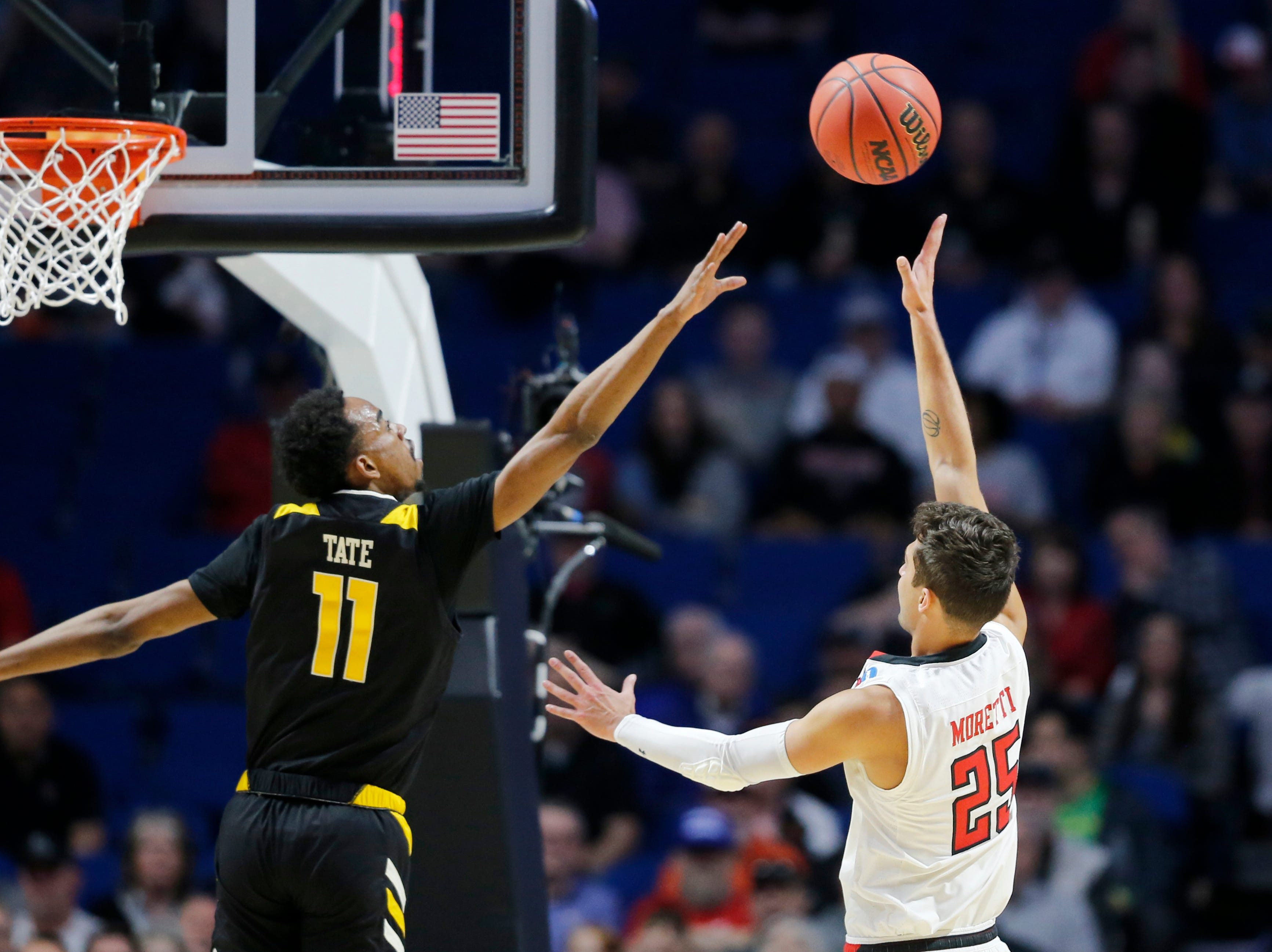 Texas Tech Red Raiders guard Davide Moretti (25) shoots over Northern Kentucky Norse guard Jalen Tate (11) in the first half of the NCAA Tournament First Round game between the 14-seeded Northern Kentucky Norse and the 3-seeded Texas Tech Red Raiders the BOK Center in downtown Tulsa on Friday, March 22, 2019. Texas Tech led 30-26 at halftime.