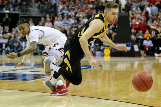 Iowa Hawkeyes guard Jordan Bohannon (3) chases a loose ball as Cincinnati Bearcats guard Justin Jenifer (3) defends in the second half of the NCAA Tournament Round of 64 game, Friday, March 22, 2019, at Nationwide Arena in Columbus, Ohio. Cincinnati Bearcats lost to the Iowa Hawkeyes 79-72.