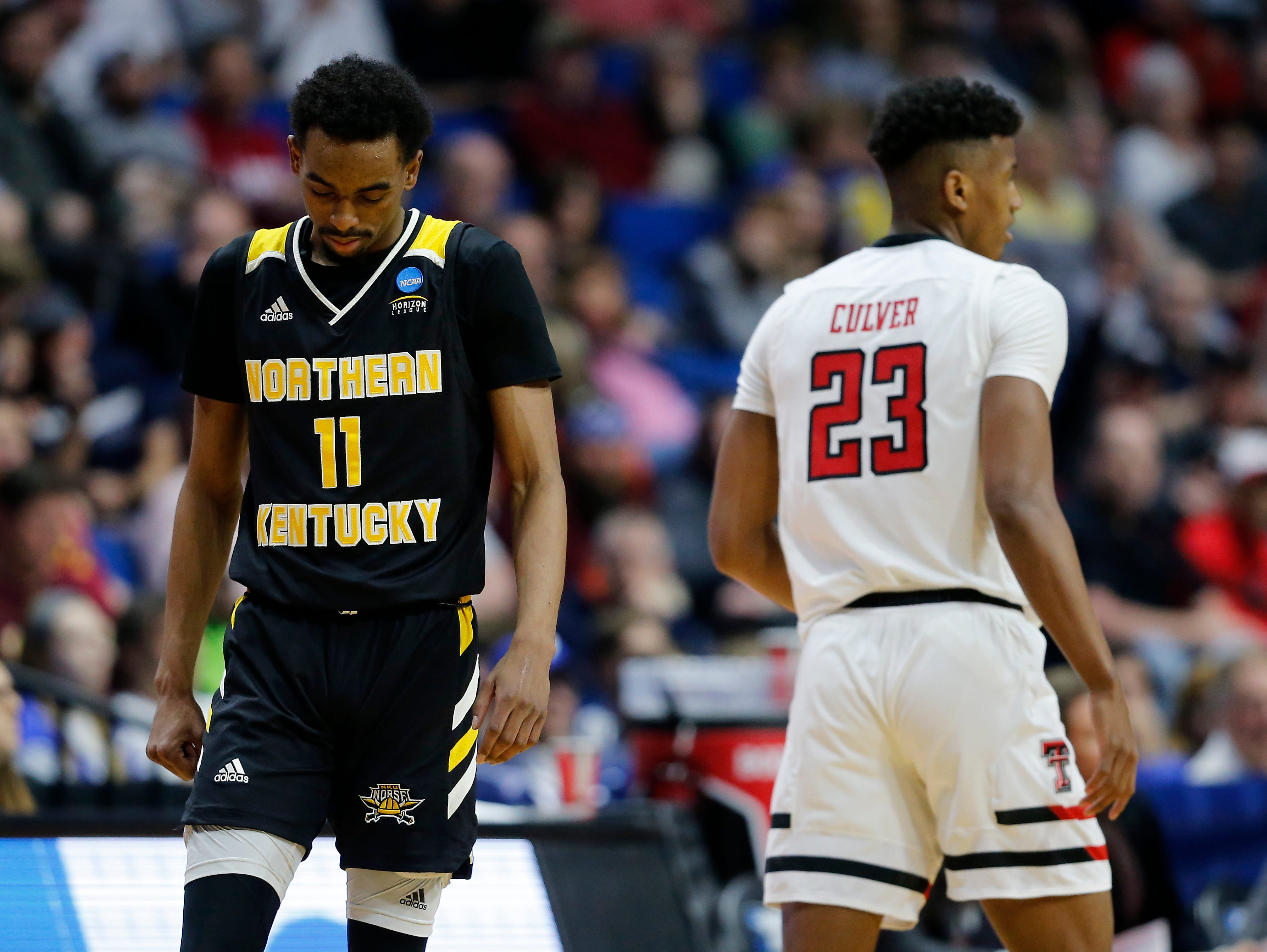 Northern Kentucky Norse guard Jalen Tate (11) goes back on defense after a turnover in the second half of the NCAA Tournament First Round game between the 14-seeded Northern Kentucky Norse and the 3-seeded Texas Tech Red Raiders the BOK Center in downtown Tulsa on Friday, March 22, 2019. NKU was knocked from the tournament with a 72-57 loss to the Red Raiders.
