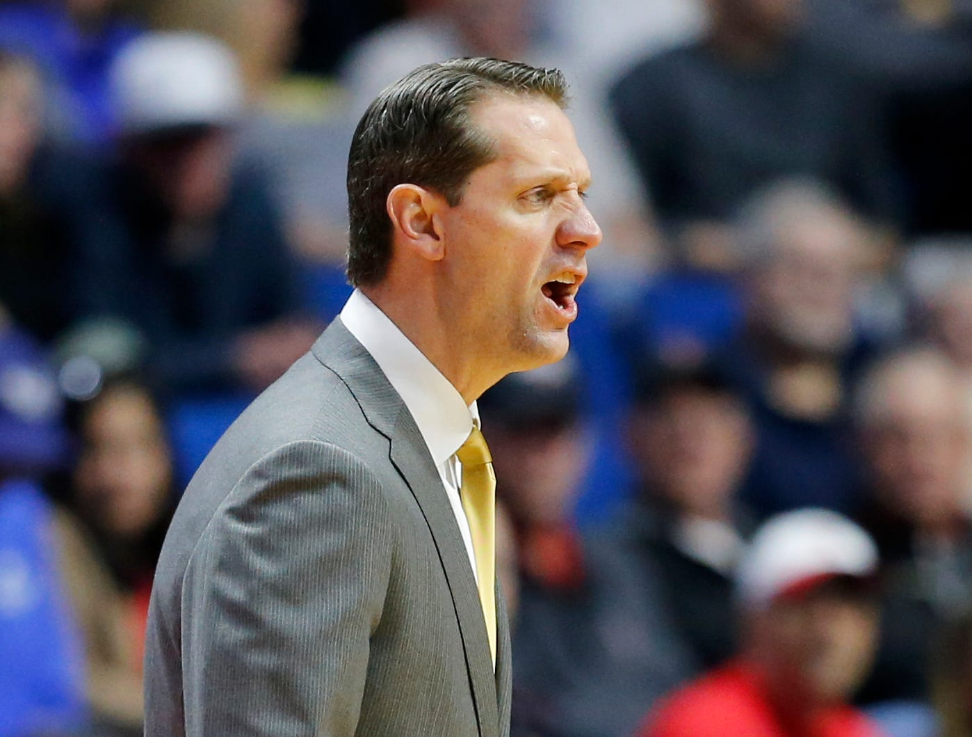 Northern Kentucky Norse head coach John Brannen shouts to his defense in the first half of the NCAA Tournament First Round game between the 14-seeded Northern Kentucky Norse and the 3-seeded Texas Tech Red Raiders the BOK Center in downtown Tulsa on Friday, March 22, 2019. Texas Tech led 30-26 at halftime.
