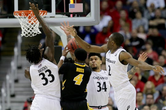Iowa Hawkeyes guard Isaiah Moss (4) takes it to the basket as Cincinnati Bearcats center Nysier Brooks (33), Cincinnati Bearcats guard Jarron Cumberland (34) and Cincinnati Bearcats guard Keith Williams (2) defend in the first half of the NCAA Tournament Round of 64 game, Friday, March 22, 2019, at Nationwide Arena in Columbus, Ohio.