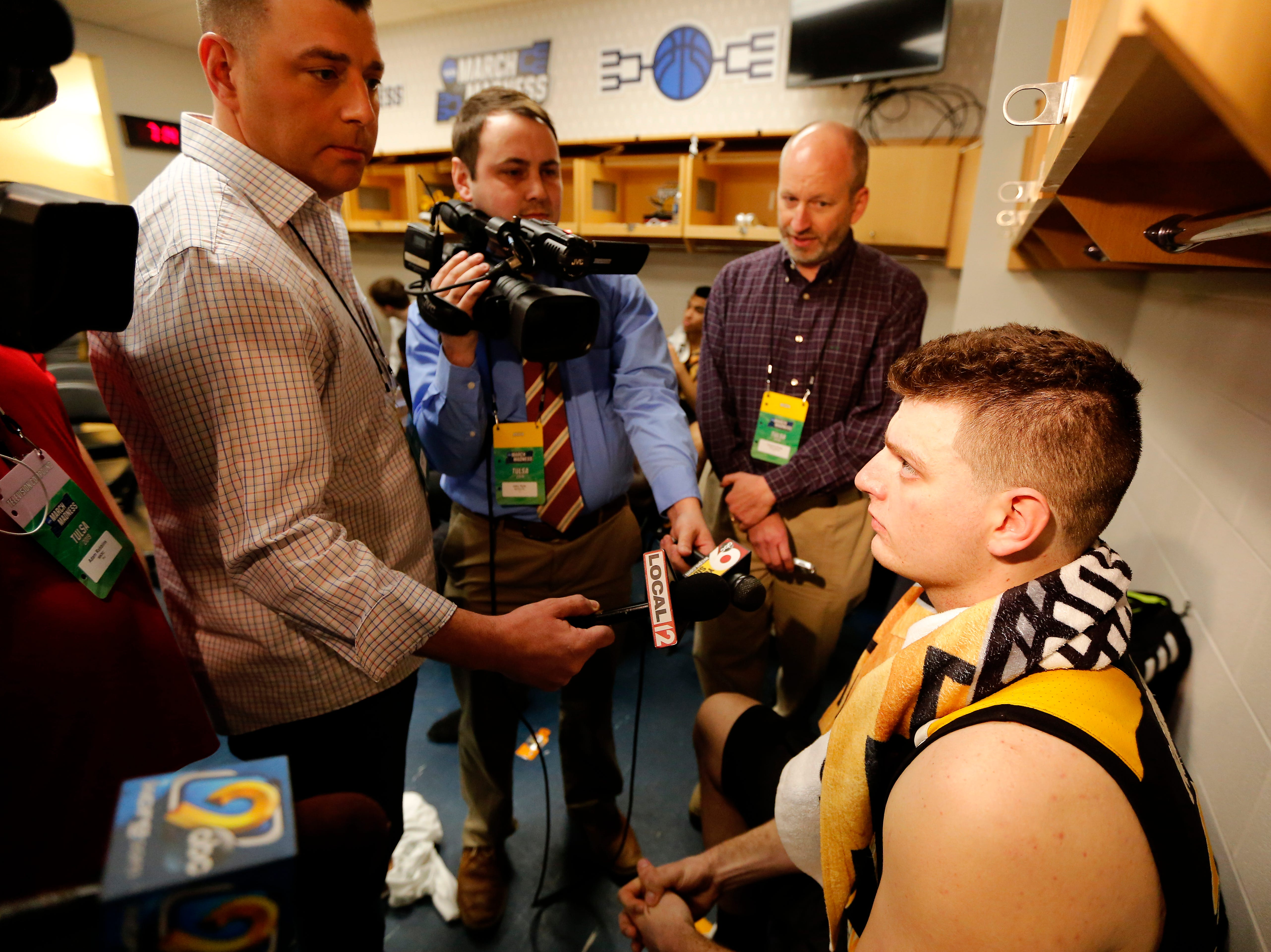 Northern Kentucky Norse forward Drew McDonald (34) talks with the media in the locker room after NCAA Tournament First Round game between the 14-seeded Northern Kentucky Norse and the 3-seeded Texas Tech Red Raiders the BOK Center in downtown Tulsa on Friday, March 22, 2019. NKU was knocked from the tournament with a 72-57 loss to the Red Raiders.