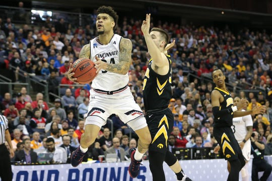 Cincinnati Bearcats guard Jarron Cumberland (34) finishes at the basket as Iowa Hawkeyes guard Jordan Bohannon (3) defends in the second half of the NCAA Tournament Round of 64 game, Friday, March 22, 2019, at Nationwide Arena in Columbus, Ohio. Cincinnati Bearcats lost to the Iowa Hawkeyes 79-72.