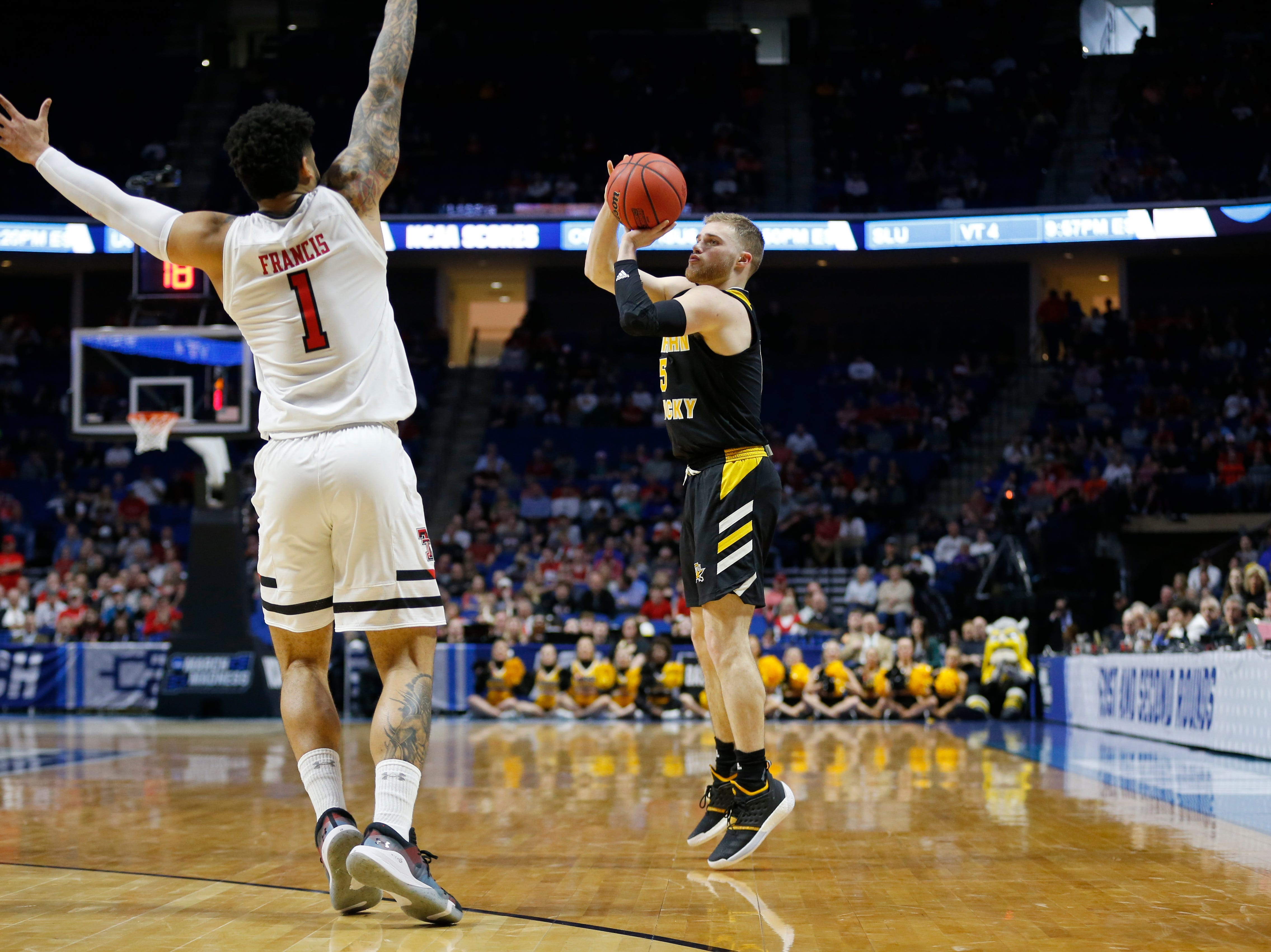 Northern Kentucky Norse guard Tyler Sharpe (15) scores from three point range in the first half of the NCAA Tournament First Round game between the 14-seeded Northern Kentucky Norse and the 3-seeded Texas Tech Red Raiders the BOK Center in downtown Tulsa on Friday, March 22, 2019. Texas Tech led 30-26 at halftime.