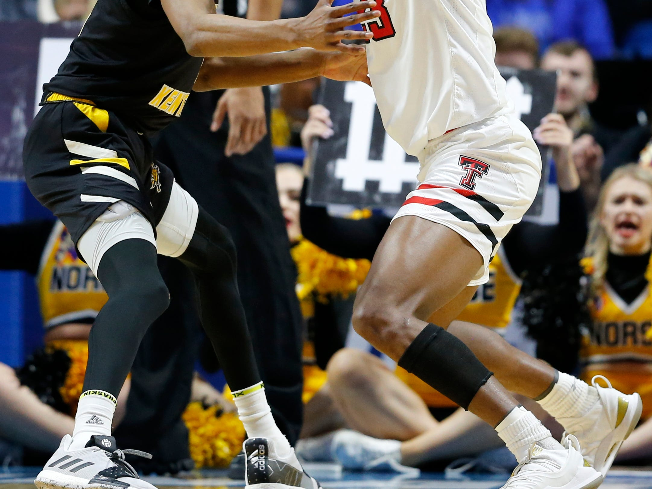 Northern Kentucky Norse guard Jalen Tate (11) gets an elbow to the jaw as he guards Texas Tech Red Raiders guard Jarrett Culver (23) in the first half of the NCAA Tournament First Round game between the 14-seeded Northern Kentucky Norse and the 3-seeded Texas Tech Red Raiders the BOK Center in downtown Tulsa on Friday, March 22, 2019. Texas Tech led 30-26 at halftime.