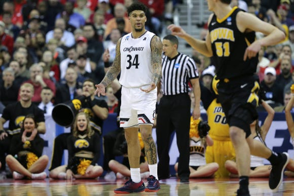 Cincinnati Bearcats guard Jarron Cumberland (34) gestures toward the bench after Iowa Hawkeyes forward Nicholas Baer (51), foreground, makes a 3-point basket in the second half of the NCAA Tournament Round of 64 game, Friday, March 22, 2019, at Nationwide Arena in Columbus, Ohio. Cincinnati Bearcats lost to the Iowa Hawkeyes 79-72.