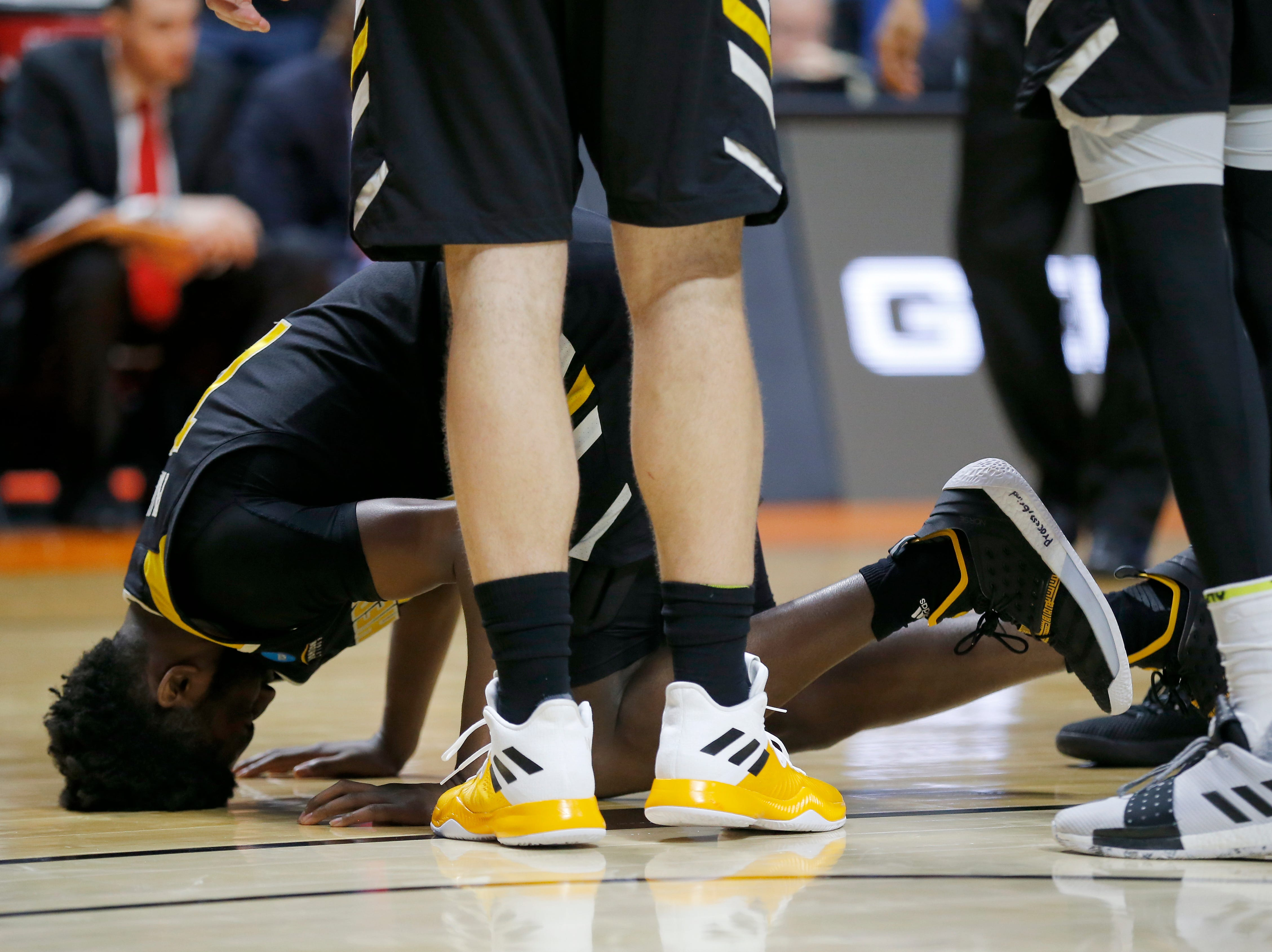 Northern Kentucky Norse guard Trevon Faulkner (12) hesitates to get up after injuring his lower leg colliding with Texas Tech Red Raiders guard Jarrett Culver (23) in the second half of the NCAA Tournament First Round game between the 14-seeded Northern Kentucky Norse and the 3-seeded Texas Tech Red Raiders the BOK Center in downtown Tulsa on Friday, March 22, 2019. NKU was knocked from the tournament with a 72-57 loss to the Red Raiders.