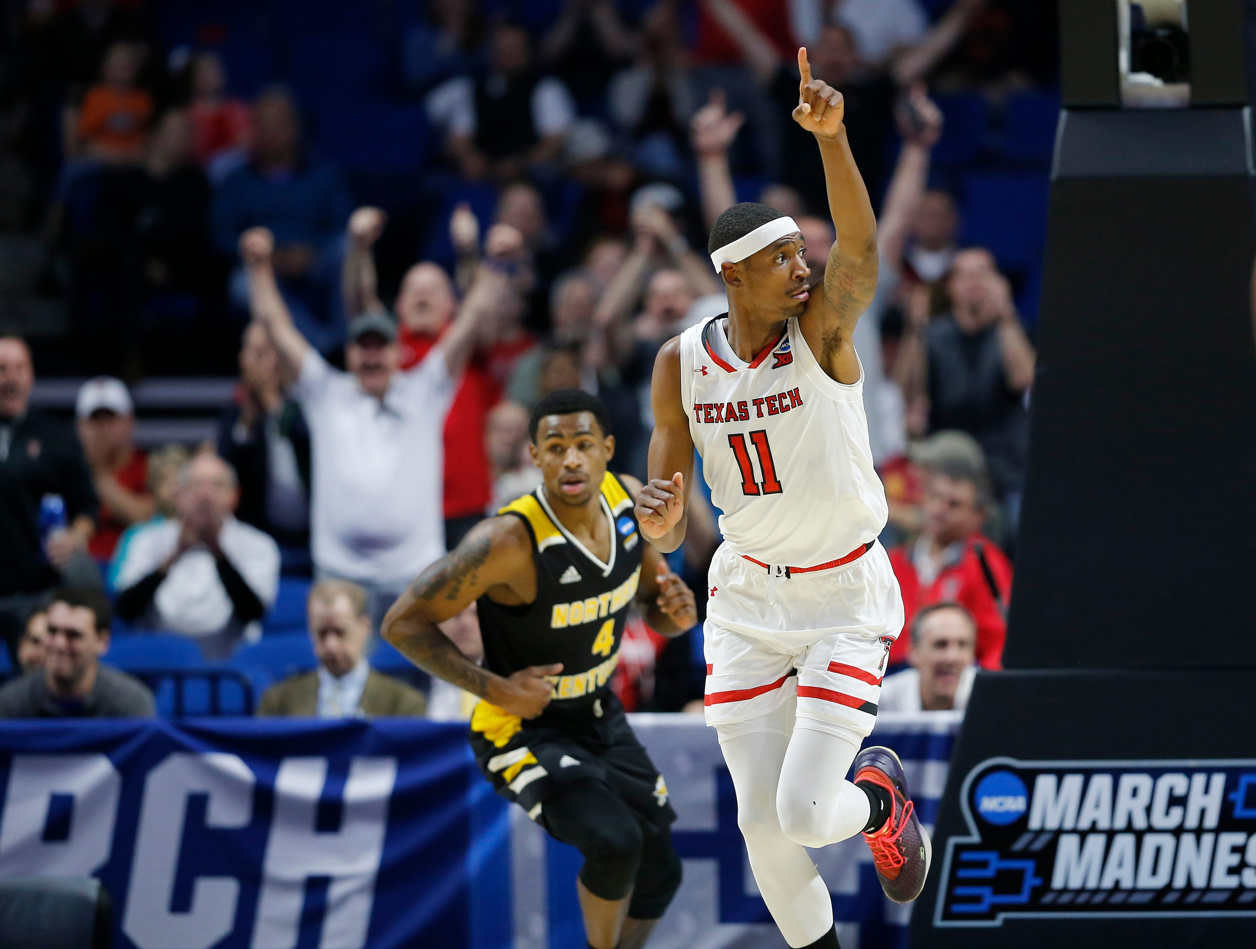 Texas Tech Red Raiders forward Tariq Owens (11) celebrates after a dunk in the first half of the NCAA Tournament First Round game between the 14-seeded Northern Kentucky Norse and the 3-seeded Texas Tech Red Raiders the BOK Center in downtown Tulsa on Friday, March 22, 2019. Texas Tech led 30-26 at halftime.