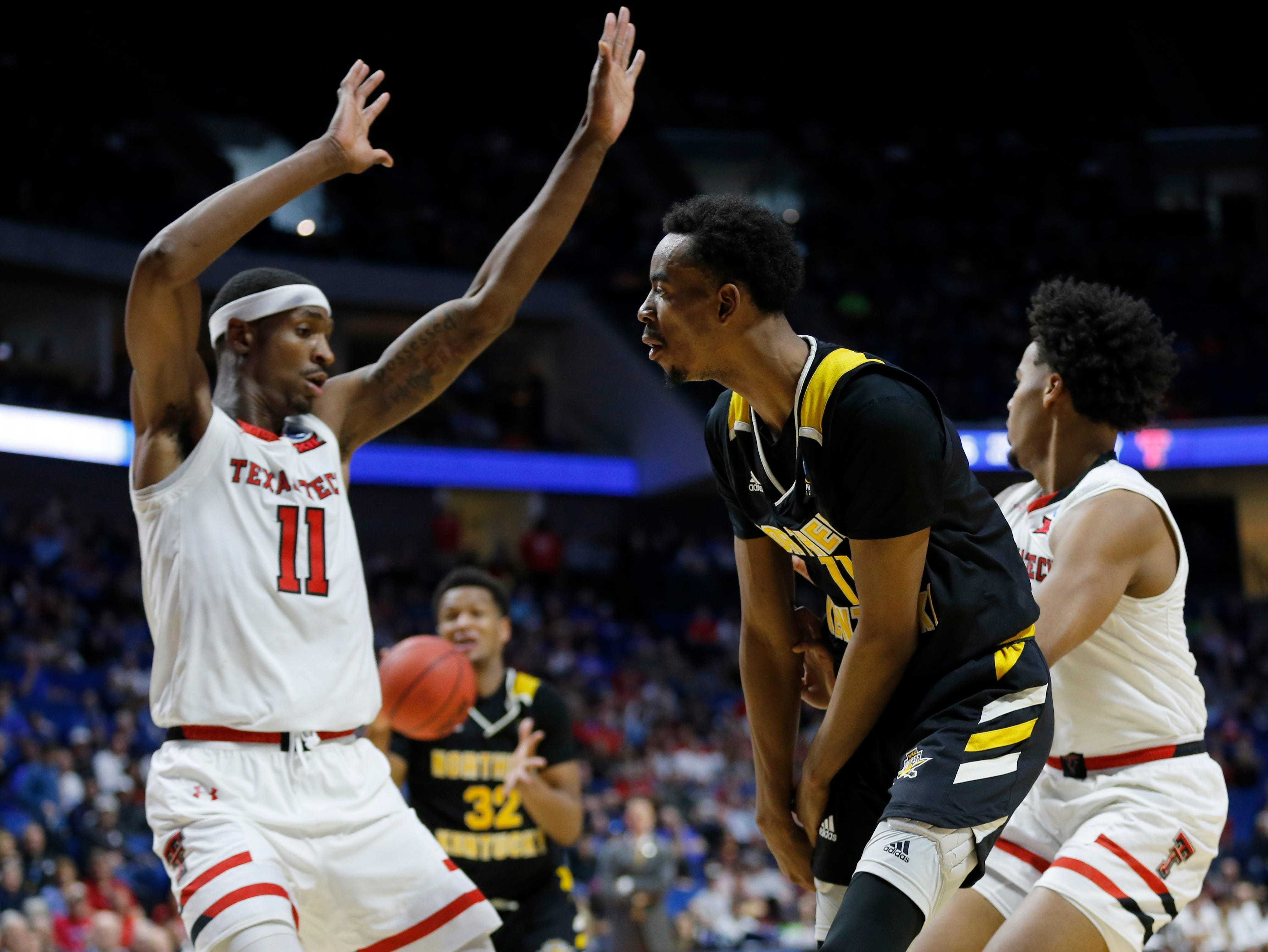 Northern Kentucky Norse guard Jalen Tate (11) throws a no-look pass to forward Dantez Walton (32) in the first half of the NCAA Tournament First Round game between the 14-seeded Northern Kentucky Norse and the 3-seeded Texas Tech Red Raiders the BOK Center in downtown Tulsa on Friday, March 22, 2019. Texas Tech led 30-26 at halftime.